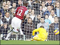 Carlton Cole slots West Ham ahead against Tottenham at Upton Park