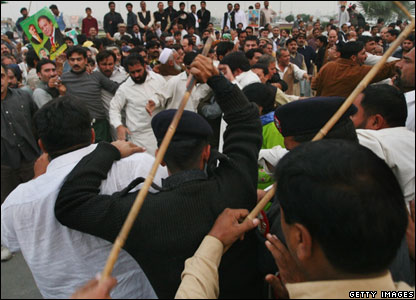 A crowd of supporters clash with police