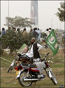 Supporters waving flags bearing the image of Mr Sharif
