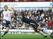 Spurs striker Robbie Keane chips over Hammers keeper Robert Green before being brought down but failing to win a penalty in the 1-1 draw at Upton Park