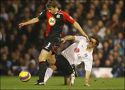 Wales captain Simon Davies challenges Stephen Warnock as Fulham take on Blackburn