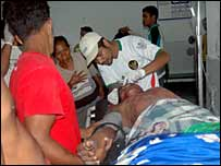 Medics treat an injured man in Sumbawa, 26/11