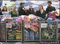 Shoppers wait to pay for their goods