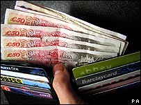 A wallet containing £50 notes