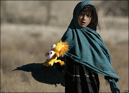 An Afghan girl holds a toy in Paktika, Afghanistan