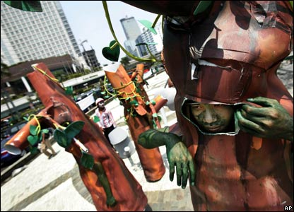 Indonesian environmental activists dressed as trees protest in central Jakarta against the destruction of Indonesia's forests