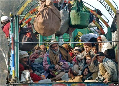 Pakistani families are evacuated from the conflict area of Matta, in Pakistan's troubled Swat valley