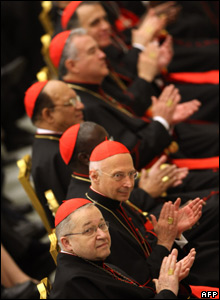 Newly appointed cardinals applaud during a Pope Benedict XVI mass in their honour in St Peter's Basilica in the Vatican