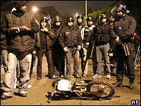 French riot examine motorcycle after collision with police car - 25/10/2007