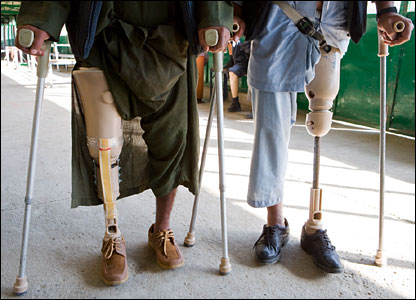 Afghan men use crutches and prosthetic legs