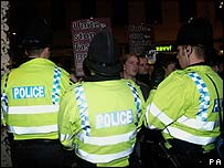Police officers and protesters