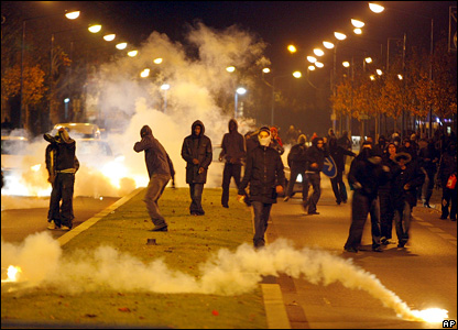 Rioting youths stand amid tear gas in Villiers-le-Bel