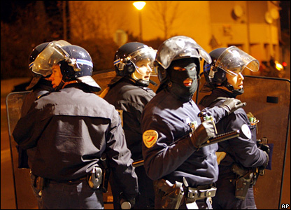 Riot police look around during clashes in Villiers-le-Bel