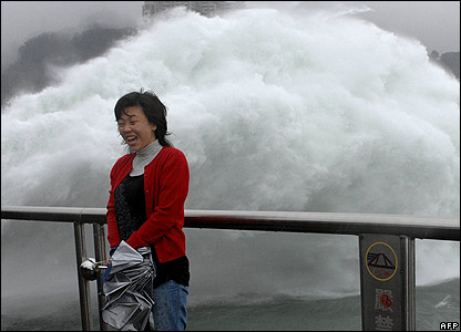 Taiwanese woman in front of dam