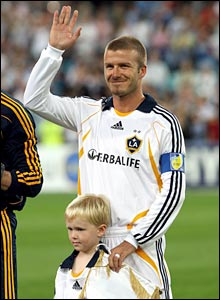 David Beckham waves to the crowd in Sydney ahead of the match