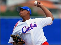 Elier Sanchez of Cuba throws a pitch