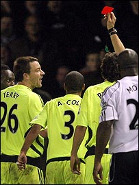 John Terry makes his feelings clear to referee Andre Marriner after the dismissal of Michael Essien (far left)