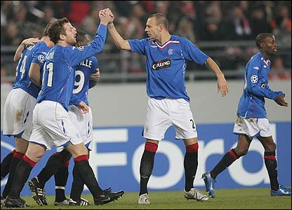 Rangers players celebrate the goal
