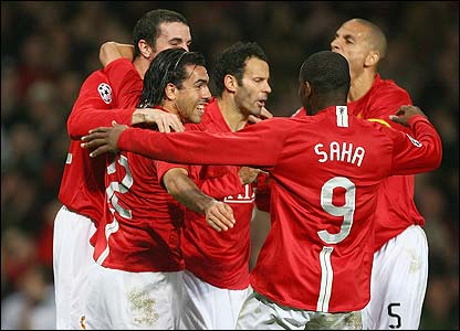Carlos Tevez is congratulated by his Manchester United team-mates