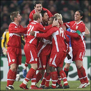 Pavel Pardo is mobbed after putting Stuttgart ahead