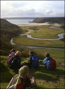 Teacher Matthew Blackmore sent us this picture of year five children from Gwyrosydd primary school, Swansea, looking out at the river at Three Cliffs Bay, Gower.