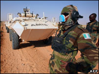 Members of the African Union Mission in Sudan (AMIS) stand in front of an armoured personnel car in Darfur (8/11/2007)