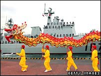 Performers celebrate the Chinese naval missile destroyer Shenzhen as it docks in Tokyo on Wednesday
