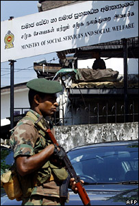 Sri Lankan soldier outside the Ministry of Social Services and Social Welfare in Colombo