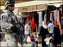 US soldier patrols market in the Dora area of Baghdad -
