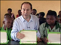 Rory Cellan-Jones sitting in a classroom with the XO laptop