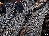 Chinese workers sit on steel bars in Guangzhou