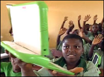 A Nigerian child holds up a $100 laptop.