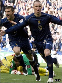 Kenny Miller celebrates the opening goal against Ukraine at Hampden
