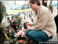 A woman pays her respects at a Vancouver memorial