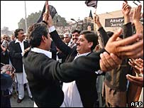 Lawyers celebrate the stepping down of President Musharraf as army chief, in Peshawar 28 November 2007