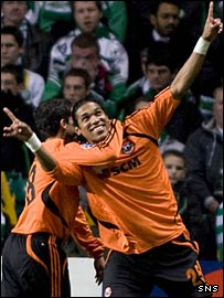 Brandao (right) celebrates opening the scoring