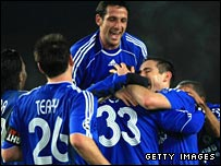 Alex is mobbed after scoring Chelsea's third in Norway