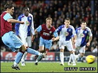 Gareth Barry (left) scores the decisive second from the penalty spot