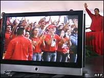 Venezuelan President Hugo Chavez waves to supporters on Wednesday