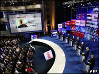 Republican presidential candidates listen to questions posed by a YouTube user during a debate in St Petersburg, Florida