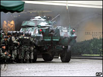Army tank outside the Peninsula Hotel in Manila on 29 November 2007