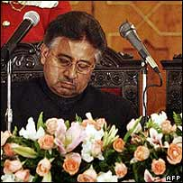 Mr Musharraf signs in as a civilian president