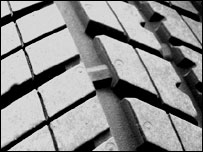 Tyre tread with wear strip moulded in