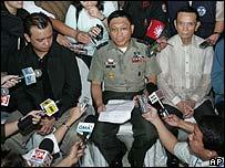 Rebel leaders speaking to the media