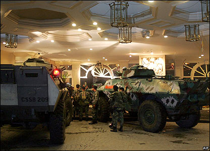 Philippine military vehicles on the driveway in front of the main entrance to the Peninsula Hotel, Manila.