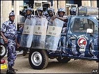 Police outside the court in Khartoum