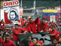 President Hugo Chavez, (centre) waves to supporters at a rally for a constitutional referendum in Cordero, Venezuela  (28.11)