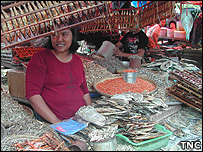 Woman selling dried fish (Image: TNC)