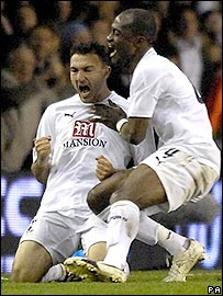 Steed Malbranque (left0 and Didier Zokora celebrate Spurs' equaliser in the 3-2 draw with Aalborg