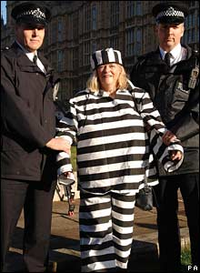 Anne Widdecombe held by officers in front of Parliament